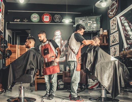 small business owner and employee in barbershop